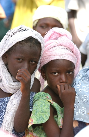 DIOSSONG, SENEGAL. (c) Chet Gordon Senegalese Muslim girls watching a reception for visiting dignitaries in Diossong, Senegal on Tuesday, October 31, 2006. © Chet Gordon/ THE IMAGE WORKS