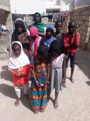 Visiting Children to Feed near QSV Dakar Office